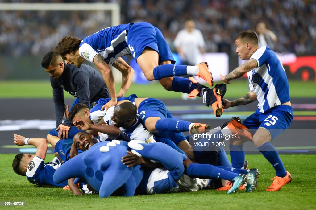 Porto's players celebrate after winning the league title following the Portuguese league football match between FC Porto and CD Feirense at the Dragao stadium in Porto on May 6, 2018.