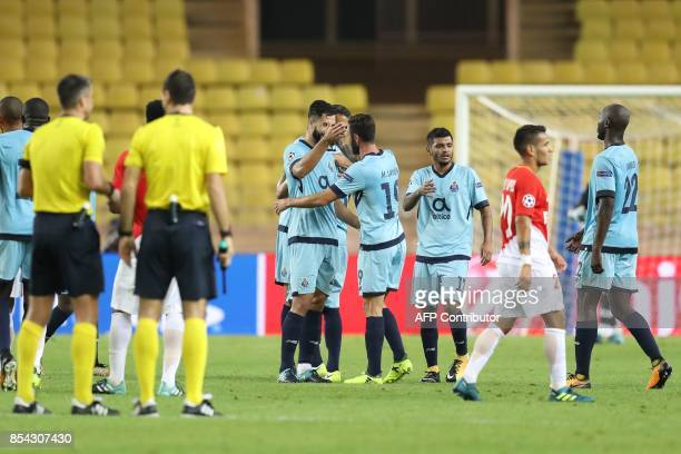 Porto's players celebrate after winning the UEFA Champions League Group G football match AS Monaco FC vs FC Porto on September 26 2017 at the Louis...
