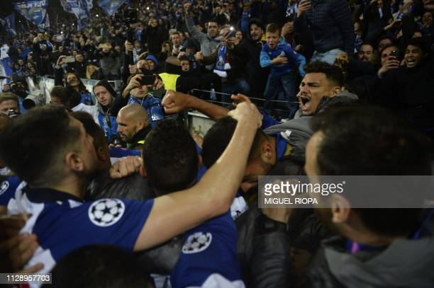 Porto's players celebrate with fans after scoring a goal during the UEFA Champions League round of 16 second leg football match between FC Porto and...
