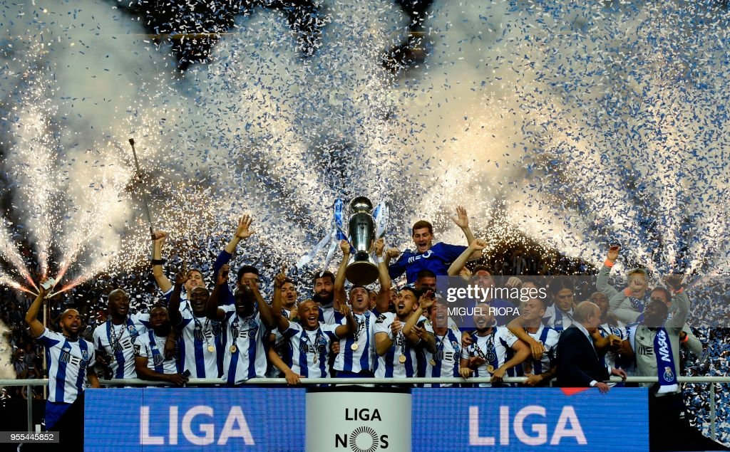 Porto's players celebrate with the trophy after winning the league title following the Portuguese league football match between FC Porto and CD Feirense at the Dragao stadium in Porto on May 6, 2018.
