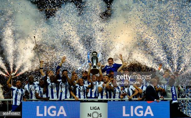 Porto's players celebrate with the trophy after winning the league title following the Portuguese league football match between FC Porto and CD...