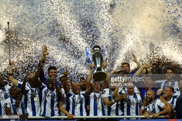 TOPSHOT Porto's players celebrate with the trophy after winning the league title following the Portuguese league football match between FC Porto and...