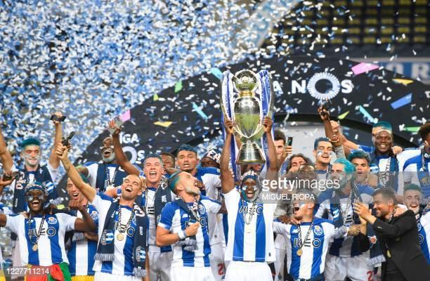 Porto's players celebrate with the trophy after winning the Portuguese Primeira Liga title at the end of the Portuguese League football match FC...