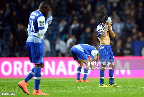 Porto's players gesture after losing the Portuguese League football match FC Porto vs FC Arouca at the Dragao stadium in Porto on February 7 2016 AFP...