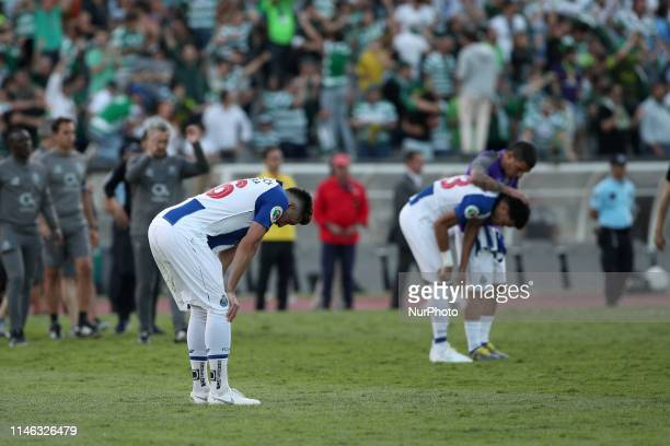 Porto's players react after losing the Portugal Cup Final football match Sporting CP vs FC Porto at Jamor stadium on May 25 in Oeiras outskirts of...