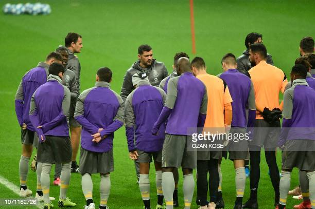 Porto's Portuguese coach Sergio Conceicao and his players take part in a training session at the TT Ali Sami Yen sport complex in Istanbul on...