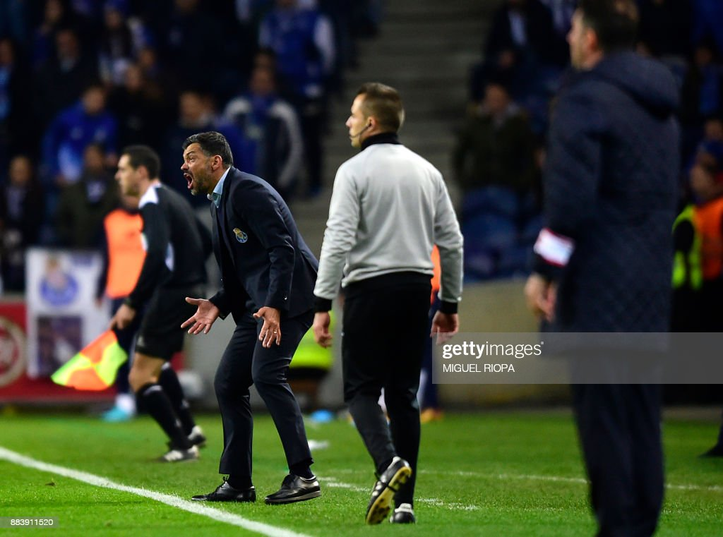 Porto's Portuguese coach Sergio Conceicao gestures on the sideline during the Portuguese league football match FC Porto vs SL Benfica at the Dragao stadium in Porto on December 1, 2017. /