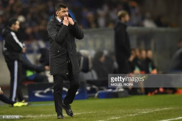 Porto's Portuguese coach Sergio Conceicao gestures on the touchline during the UEFA Champions League round of sixteen first leg football match...