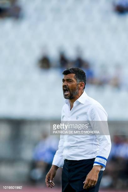Henrique Almeida of CF Os Belenenses with Alex Telles of FC Porto in action during the Liga NOS match between CF Os Belenenses and FC Porto at...