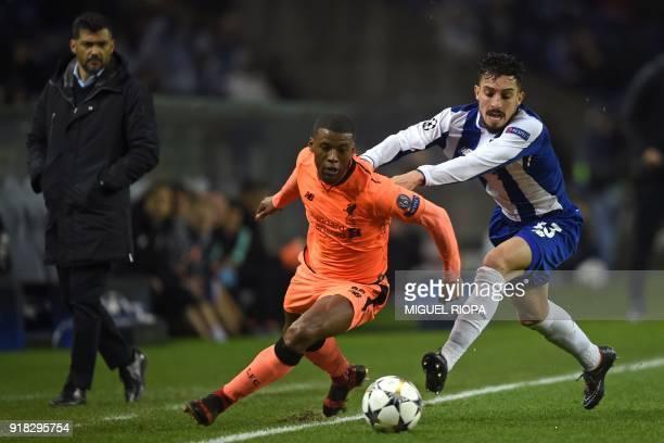 Porto's Portuguese coach Sergio Conceicao watches as Liverpool's Dutch midfielder Georginio Wijnaldum runs away from Porto's Brazilian defender Alex...