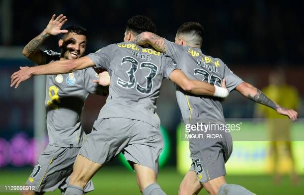 Porto's Portuguese defender Pepe celebrates a goal with teammates during the Portuguese league football match CD Feirense and FC Porto at the...
