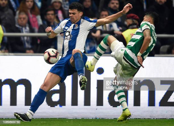 Porto's Portuguese defender Pepe challenges Sporting's Brazilian forward Raphinha during the Portuguese Taca da Liga or League Cup final football...