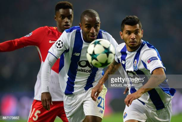 Porto's Portuguese defender Ricardo Pereira runs for the ball with teammate Porto's Mexican forward Jesus Corona and Monaco's French forward Adama...