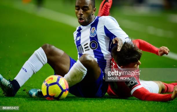 Porto's Portuguese defender Ricardo Pereira vies with Benfica's Argentinian defender Franco Cervi during the Portuguese league football match FC...