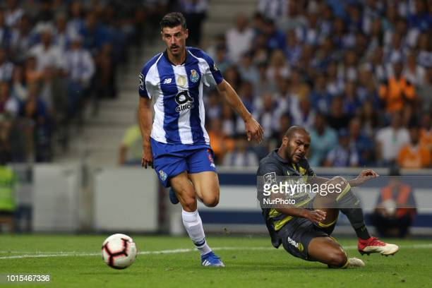 Porto's Portuguese forward Andre Pereira in action with GD Chaves Brazilian defender Marcao during the Premier League 2018/19 match between FC Porto...