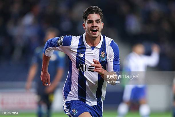 Porto's Portuguese forward Andre Silva celebrates after scoring a goal during the Premier League 2016/17 match between FC Porto and Moreirense at...
