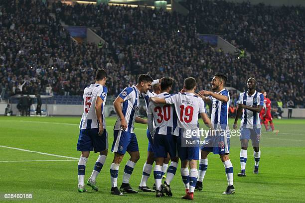 Porto's Portuguese forward Andre Silva celebrates after scoring goal with teammates during the UEFA Champions League Group G match between FC Porto...
