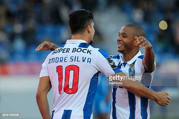 Porto's Portuguese forward Andre Silva celebrates after scoring goal with teammate Porto's Algerian forward Yacine Brahimi during the Premier League...