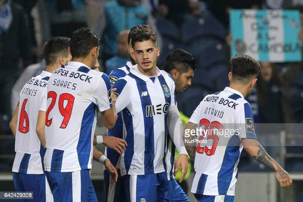 Porto's Portuguese forward Andre Silva celebrates after scoring goal with teammates during the Premier League 2016/17 match between FC Porto and CD...