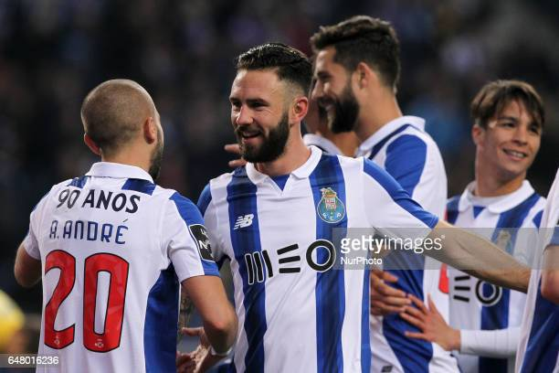 Porto's Portuguese forward Andre Silva celebrates with teammate Porto's Mexican defender Miguel Layun during the Premier League 2016/17 match between...