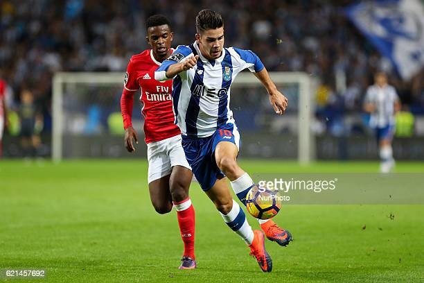 Porto's Portuguese forward Andre Silva in action with Benfica's Portuguese defender Nelson Semedo during the Premier League 2016/17 match between FC...