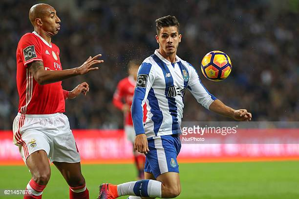 Porto's Portuguese forward Andre Silva in action with Benfica's Brazilian defender Luisao during the Premier League 2016/17 match between FC Porto...