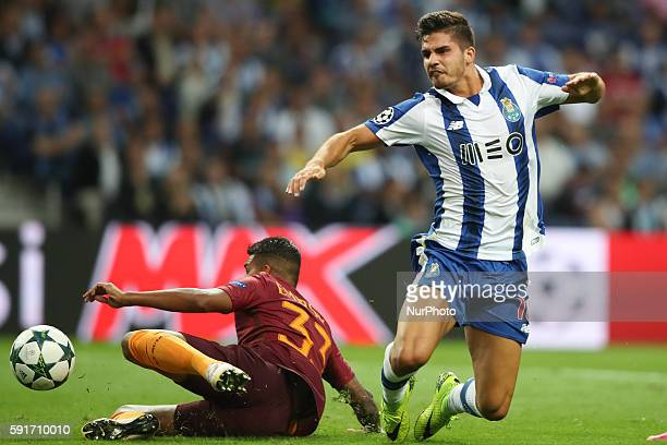 Porto's Portuguese forward Andre Silva in action with Roma's Brazilian defender Emerson Palmieri during the UEFA Champions League match between FC...