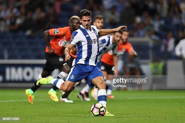 Porto's Portuguese forward Andre Silva scores on a penalty kick during the Premier League 2016/17 match between FC Porto and Boavista FC at Dragao...