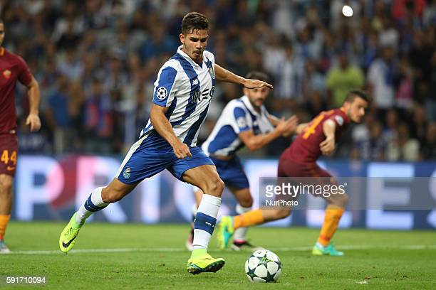 Porto's Portuguese forward Andre Silva scores on a penalty kickl during the UEFA Champions League match between FC Porto and AS Roma at Dragao...