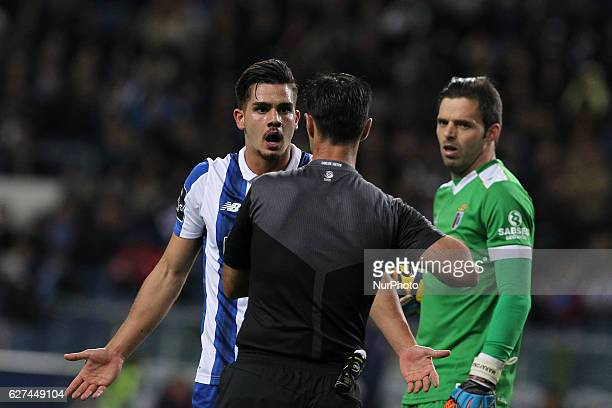 Porto's Portuguese forward Andre Silva take the yellow card during the Premier League 2016/17 match between FC Porto and SC Braga at Dragao Stadium...