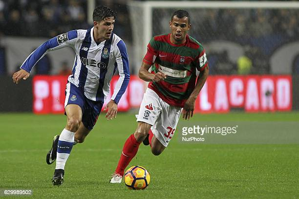 Porto's Portuguese forward Andre Silva with Maritimo's Brazil midfielder Fransergio during the Premier League 2016/17 match between FC Porto and CS...