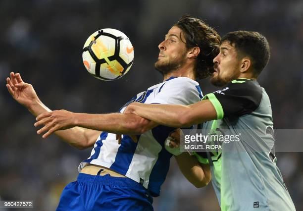 Porto's Portuguese forward Goncalo Paciencia controls the ball next to Vitoria FC's Portuguese defender Nuno Reis during the Portuguese league...