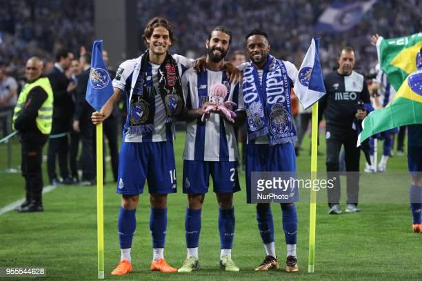 Porto's Portuguese forward Goncalo Paciencia Porto's Portuguese midfielder Sergio Oliveira and Porto's Portuguese forward Hernani celebrates the...