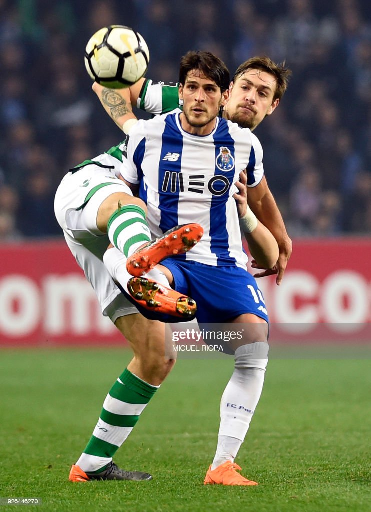 Porto's Portuguese forward Goncalo Paciencia (R) vies with Sporting's Uruguayan defender Sebastien Coates during the Portuguese league football match FC Porto against Sporting CP at the Dragao stadium in Porto on March 02, 2018. /