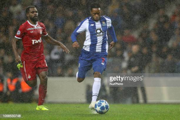 Porto's Portuguese forward Hernani vies with Bryan Idowu defender of FC Lokomotiv Moscow during the UEFA Champions League match between FC Porto and...