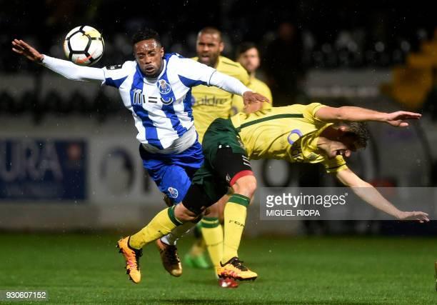 Porto's Portuguese forward Hernani vies with Pacos de Ferreira's Portuguese defender Filipe Ferreira during the Portuguese league football match...