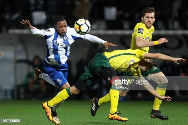 Porto's Portuguese forward Hernani vies with Pacos Ferreira's Portuguese defender Filipe Ferreira during the Premier League 2017/18 match between...