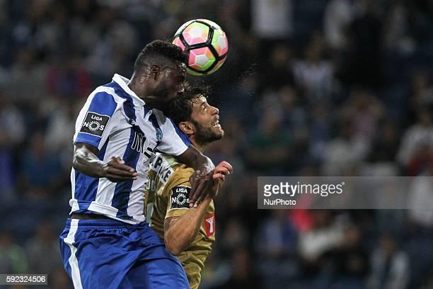 Porto's Portuguese forward Silvestre Varela jumps for a ball with Estoril´s Portuguese defender Joel during the Premier League 2016/17 match between...