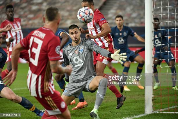 Porto's Portuguese goalkeeper Diogo Costa watches the ball during the UEFA Champions League Group C football match between Olympiakos and FC Porto on...