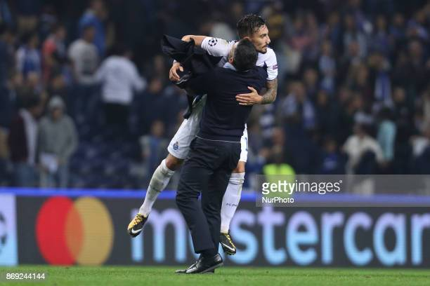 Porto's Portuguese head coach Sergio Conceicao celebrates with team the victory during the UEFA Champions League Group G match between FC Porto and...