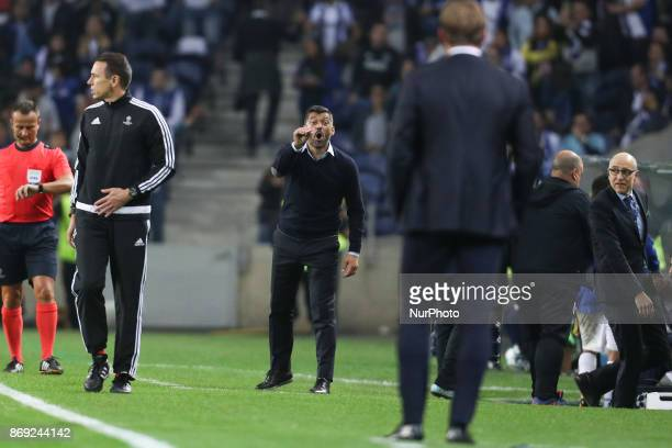 Porto's Portuguese head coach Sergio Conceicao reacts with Head coach Ralph Hasenhuttl of Leipzig during the UEFA Champions League Group G match...