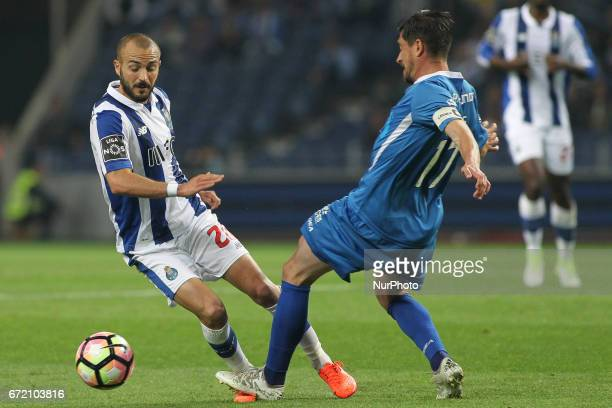 Porto's Portuguese midfielder Andre Andre compete the ball with Feirense player Cris during the Premier League 2016/17 match between FC Porto and CD...