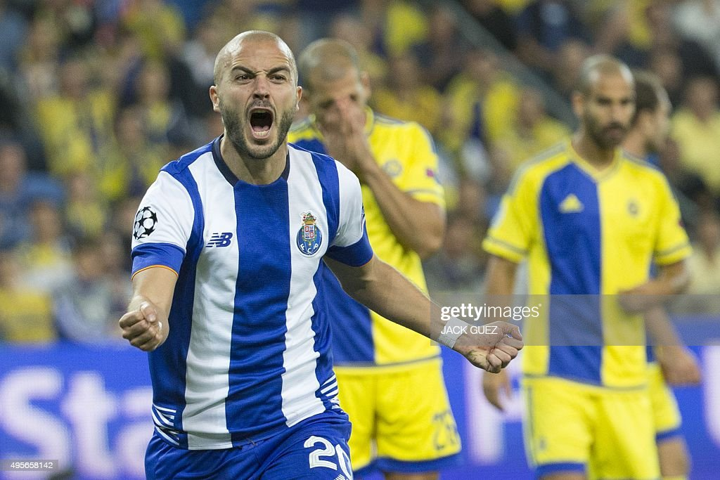 Porto's Portuguese midfielder Andre Andre (C) reacts after scoring a goal during the UEFA Champions League, group G, football match between Maccabi Tel Aviv and FC Porto at the Sammy Ofer Stadium, in the Israeli coastal city of Haifa, on November 4, 2015.