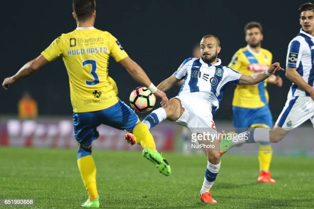 Porto's Portuguese midfielder Andre Andre vies with Arouca's Portuguese defender Hugo Bastos during Premier League 2016/17 match between FC Arouca...