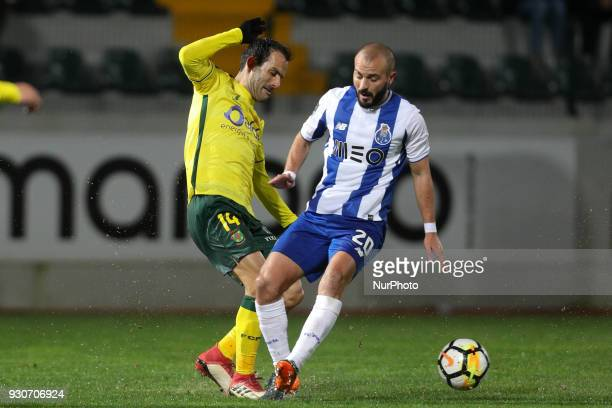Porto's Portuguese midfielder Andre Andre vies with Pacos Ferreira's midfielder Ruben Micael during the Premier League 2017/18 match between Pacos...