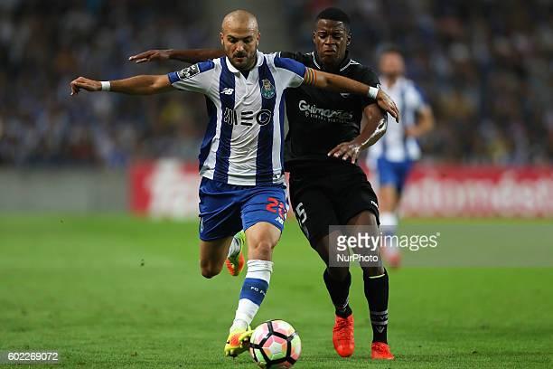 Porto's Portuguese midfielder Andre Andre vies with Vitoria SC's Portuguese forward Xande Silva during the Premier League 2016/17 match between FC...