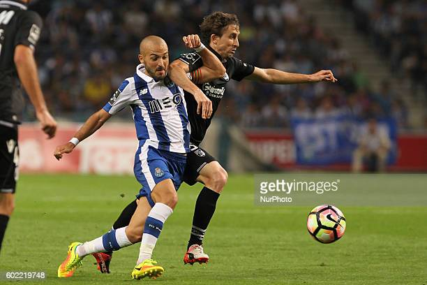 Porto's Portuguese midfielder Andre Andre with Vitoria SC's Brazilian midfielder Rafael Miranda in action during Premier League 2016/17 match between...