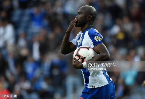 Porto's Portuguese midfielder Danilo Pereira celebrates after scoring a goal during the Portuguese League football match between Porto and Sporting...