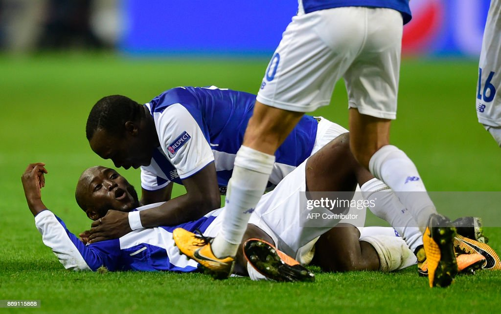 Porto's Portuguese midfielder Danilo Pereira (L) celebrates with Cameroonian forward Vincent Aboubakar after scoring a goal during the UEFA Champions League group G football match FC Porto vs Leipzig at Dragao stadium in Porto on November 1, 2017. /
