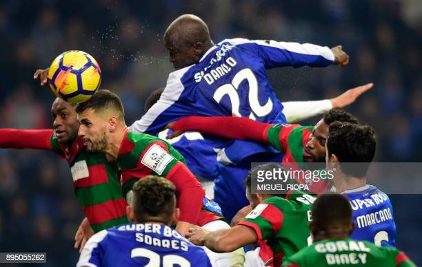 TOPSHOT Porto's Portuguese midfielder Danilo Pereira heads the ball during the Portuguese league football match FC Porto vs Maritimo at the Dragao...